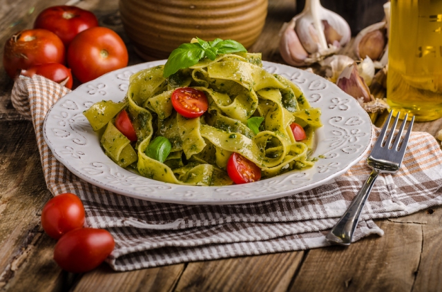 Pasta with basil pesto very simple and delicious. Pesto from olive oil basil nuts and Parmesan