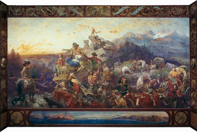 Painting by the artist Emanual Leutz depicting western expansion of the US with wagon trains, horses and settlers