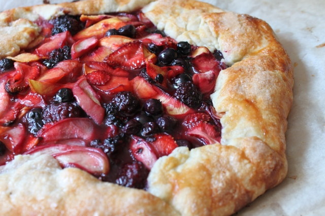 Close up of fruit tart with blueberries, raspberries, strawberries and apples